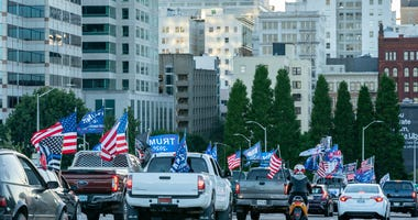 Pro-Trump supporters drive into downtown during a rally in support of the president on August 29, 2020 in Portland, Oregon.