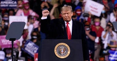 President Donald Trump leaves to cheers from a crowd during a Make America Great Again campaign rally on September 19, 2020 in Fayetteville, North Carolina.