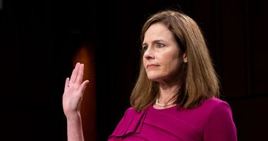 Supreme Court Justice nominee Judge Amy Coney Barrett is sworn in during the Senate Judiciary Committee confirmation hearing for Supreme Court Justice in the Hart Senate Office Building on October 12, 2020 in Washington, DC.