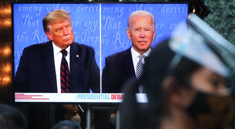 People sit to watch a broadcast of the first debate between President Donald Trump and Democratic presidential nominee Joe Biden on Tuesday, September 29, 2020.
