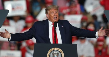 President Donald Trump speaks during his campaign event at the Orlando Sanford International Airport on October 12, 2020 in Sanford, Florida.