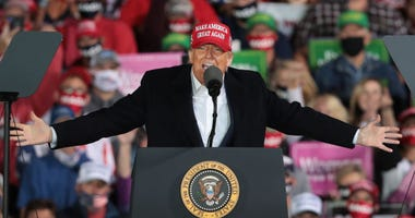 President Donald Trump speaks to supporters during a rally at the Des Moines International Airport on October 14, 2020 in Des Moines, Iowa.