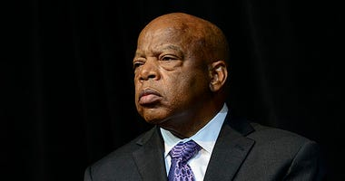 John Lewis attends the U.S. Postal Service Unveiling of the 1963 March On Washington Stamp on August 23, 2013 in Washington, United States.