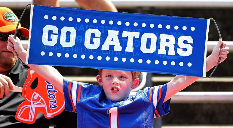 A Florida Gators fan cheers during a game at Ben Hill Griffin Stadium