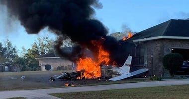 A small plane crashed into the side of a Lake City, Florida, home on Saturday, killing the pilot, according to Columbia County Sheriff's Office. No one on the ground was injured.