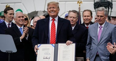U.S. President Donald Trump stands after signing the United States-Mexico-Canada Trade Agreement (USMCA) during a ceremony on the South Lawn of the White House on January 29, 2020 in Washington, DC.