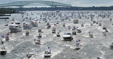 Hundreds of boats idle through downtown on the St. Johns River during a rally Sunday, June 14, 2020, in Jacksonville, Fla., celebrating President Donald Trump's birthday