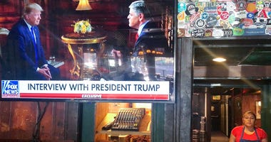 President Donald Trump's pre-game Super Bowl interview with Fox News host Sean Hannity is broadcast in a bar on February 2, 2020 in Washington, DC.