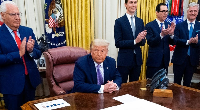 U.S. President Donald Trump leads a meeting with leaders of Israel and UAE announcing a peace agreement to establish diplomatic ties with Israel and the UAE, in the Oval Office of the White House on August 13, 2020 in Washington, DC.