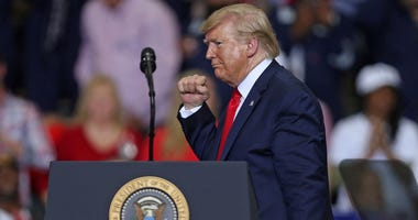 "U.S. President Donald Trump gestures during a ""Keep America Great"" rally at the Monroe Civic Center on November 06, 2019 in Monroe, Louisiana."