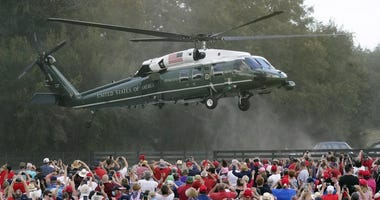 resident Donald Trump arrives in the Marine One helicopter at a campaign rally as supporters cheer Friday, Oct. 23, 2020, in The Villages, Fla.