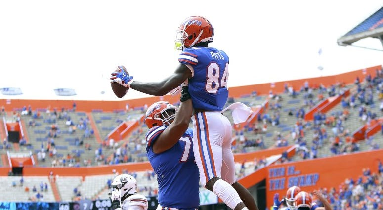 Florida tight end Kyle Pits (84) leaps up as he celebrates a touchdown catch with teammates during an NCAA college football game against South Carolina in Gainesville, Fla., Saturday, Oct. 3, 2020.