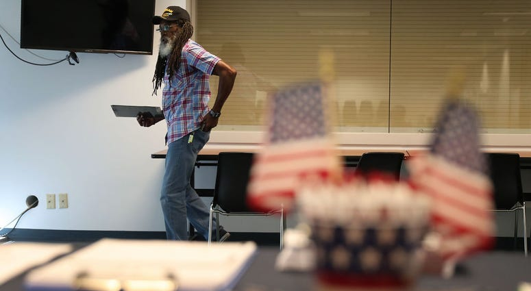 Clarence Singleton registers to vote at the Lee County Supervisor of Elections office in Fort Myers, Florida.
