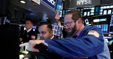 Wobbly day on Wall Street ends with record highs for S&P, Dow