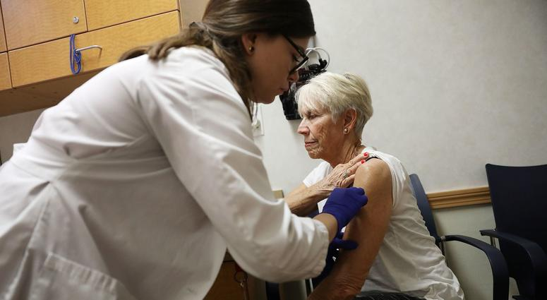 Luanne Boiko receives an influenza vaccination from nurse practitioner, Leslie Suarez, at the CVS Pharmacy store's MinuteClinic on October 4, 2018 in Miami, Florida.