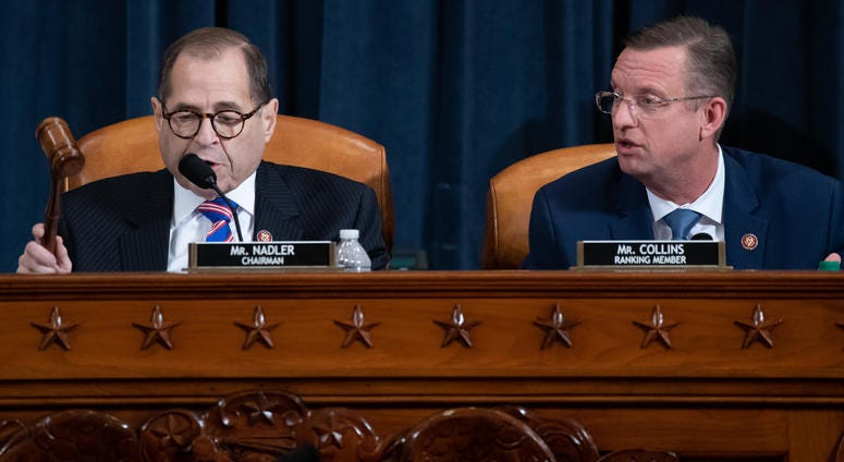 U.S. Judiciary Committee Chairman Jerrold Nadler (D-NY) gavels the committee meeting adjourned as ranking member Doug Collins (R-GA) looks on following testimony by constitutional scholars in the Longworth House Office Building on Capitol Hill December 4,