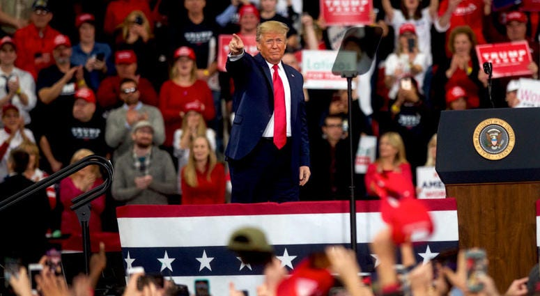 President Donald Trump acknowledges the crowd upon taking the stage during a campaign rally on December 10, 2019 in Hershey, Pennsylvania.