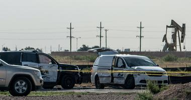 A damaged police vehicle and U.S. Postal Service van blocked off with tape nearby to where a gunman was shot and killed at Cinergy Odessa movie theater following a deadly shooting spree on September 1, 2019 in Odessa, Texas.