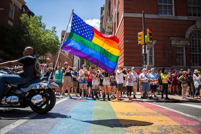 PHILADELPHIA, PA - JUNE 12: Participants of the 2016 Pride Parade march through downtown on June 12, 2016 in Philadelphia, Pennsylvania. The mood was celebratory despite news of the mass shooting this morning in a gay club in Orlando, Florida.