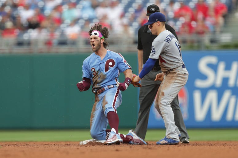 Bryce Harper #3 of the Philadelphia Phillies reacts after hitting a single and taking second base on an error that scored a run in the seventh inning during a game against the Los Angeles Dodgers at Citizens Bank Park.