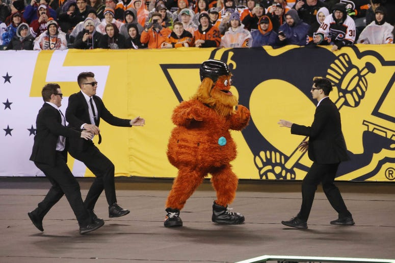 PHILADELPHIA, PENNSYLVANIA - FEBRUARY 23: The Philadelphia Flyers mascot Gritty runs through the infield during the game against the Pittsburgh Penguins during the 2019 Coors Light NHL Stadium Series game at the Lincoln Financial Field on February 23, 201