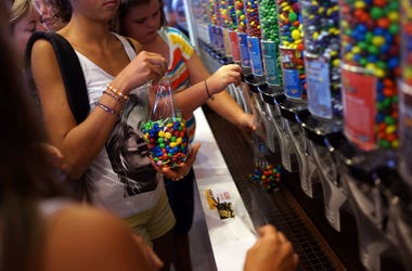 People fill up bags of M&M's at the M&M store in Times Square on July 24, 2014 in New York City. With the increase in cocoa prices, Mars Chocolate North America, the maker of Snickers and M&M's, announced an average price increase of 7 percent this week f
