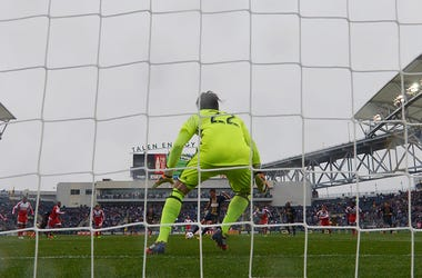 Sebastien Le Toux #9 of Philadelphia Union takes a penalty shot on Bobby Shuttleworth #22 of New England Revolution at Talen Energy Stadium on March 20, 2016 in Chester, Pennsylvania. The Union won 3-0.