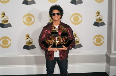 Bruno Mars poses in the press room at the 60th Annual Grammy Awards