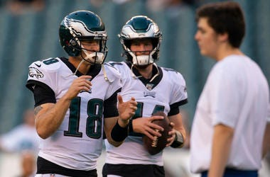 Josh McCown #18 of the Philadelphia Eagles and Carson Wentz #11 warm up prior to the preseason game against the Baltimore Ravens at Lincoln Financial Field on August 22, 2019 in Philadelphia, Pennsylvania.