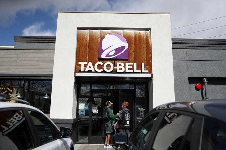 Customers enter a Taco Bell restaurant on February 22, 2018 in Novato, California. Taco Bell has become the fourth-largest domestic restaurant brand by edging out Burger King. Taco Bell sits behind the top three restaurant chains McDonald's, Starbucks and