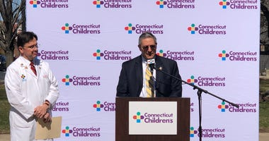 Connecticut Children's CEO Jim Shmerling with Dr. Juan Salazar to the left