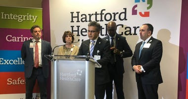 Dr. Ajay Kumar speaking at Hartford HealthCare on March 10