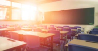Blurred Image of a School Classroom with Sun Peeking through Window