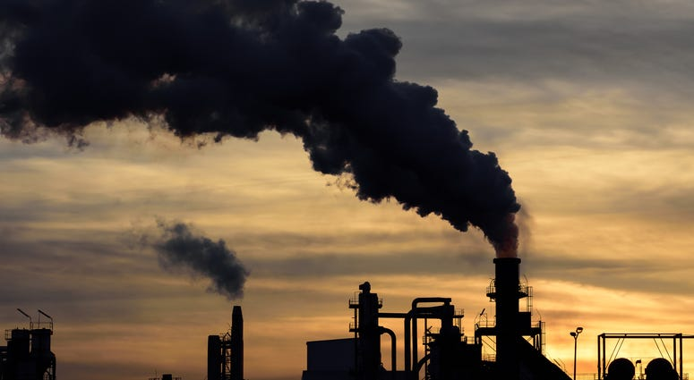A cloud of pollution released by an industry