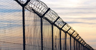 prison-fence-GettyImages-643281234.jpg