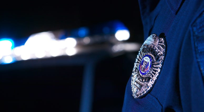 police-officer-badge-GettyImages-78029405.jpg
