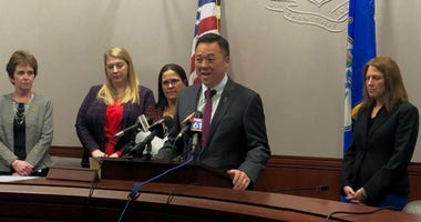 Attorney General William Tong stands at the podium at the State Capitol.