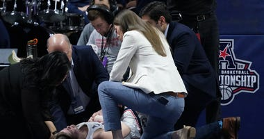 UConn Huskies forward Kyla Irwin (25) is looked after by medical staff after falling to the floor as they take on the South Florida Bulls in the second half of the American Conference Championship Semifinals at Mohegan Sun Arena. Mandatory Credit: David B