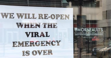 Morneault's Apparel displays one of the many closed/ coronavirus signs on Trumbull St., Hartford