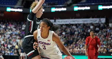 Mar 9, 2020; Uncasville, CT, USA; Cincinnati Bearcats guard Sam Rodgers (11) fouls UConn Huskies forward Megan Walker (3) in the first half of the American Conference Championship Finals at Mohegan Sun Arena.