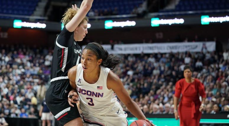 Mar 9, 2020; Uncasville, CT, USA; Cincinnati Bearcats guard Sam Rodgers (11) fouls UConn Huskies forward Megan Walker (3) in the first half of the American Conference Championship Finals at Mohegan Sun Arena.