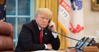 President Donald J. Trump speaks on the phone in the Oval Office