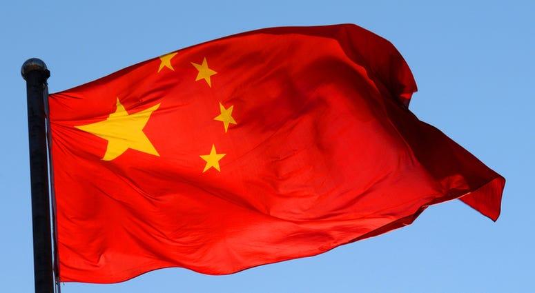 chinese-flag-dreamstime_s_46325047.jpg