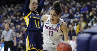 Connecticut Huskies guard Kia Nurse (11) dribbles the ball around Quinnipiac Bobcats guard Edel Thornton (11) in the first half of the women's NCAA Tournament second round game at Gampel Pavilion.