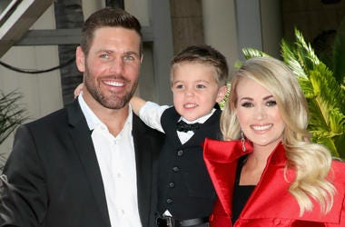 Mike Fisher and Isaiah Michael Fisher attend as Carrie Underwood is honored with a star on The Hollywood Walk of Fame