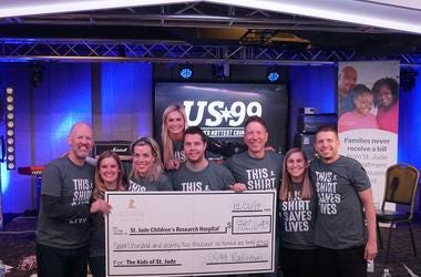 US99 staff with check for St. Jude