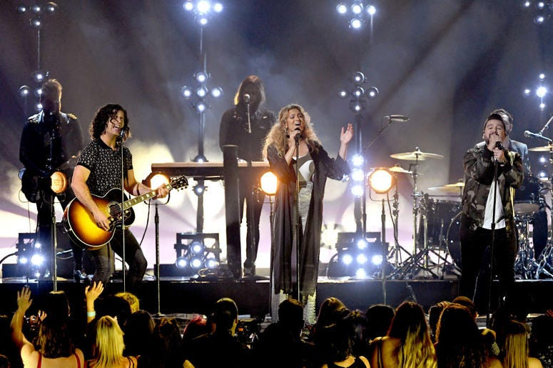 Dan + Shay, Tori Kelly perform onstage during the 2019 Billboard Music Awards at MGM Grand Garden Arena on May 01, 2019 in Las Vegas, Nevada.