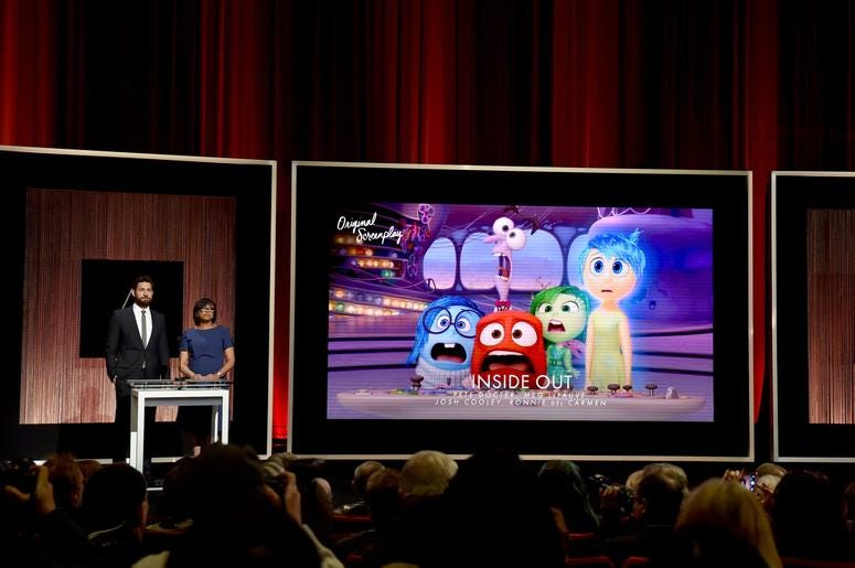 Actor John Krasinski and President of the Academy of Motion Picture Arts and Sciences Cheryl Boone Isaacs announce 'Inside Out' as a nominee for Best Writing - Original Screenplay during the 88th Oscars Nominations Announcement at the Academy of Motion Pi