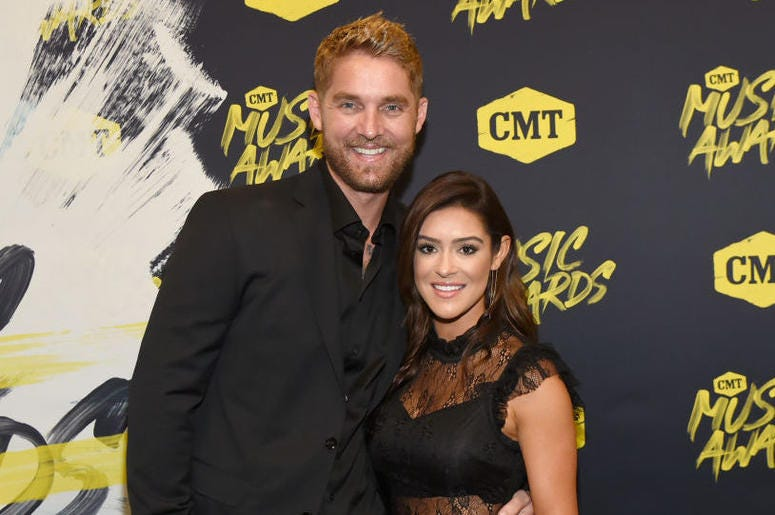 Brett Young and Taylor Mills attend the 2018 CMT Music Awards at Bridgestone Arena on June 6, 2018 in Nashville, Tennessee.