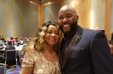 Ryan Cameron,shown with Radio.com's Maria Boynton at the 2018 Let Us Make Man Scholarship Dinner in Atlanta, remains hospitalized after an apparent heart issue